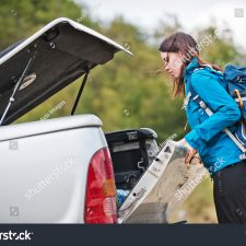 stock-photo-young-female-getting-ready-for-a-hike-in-nature-703948639