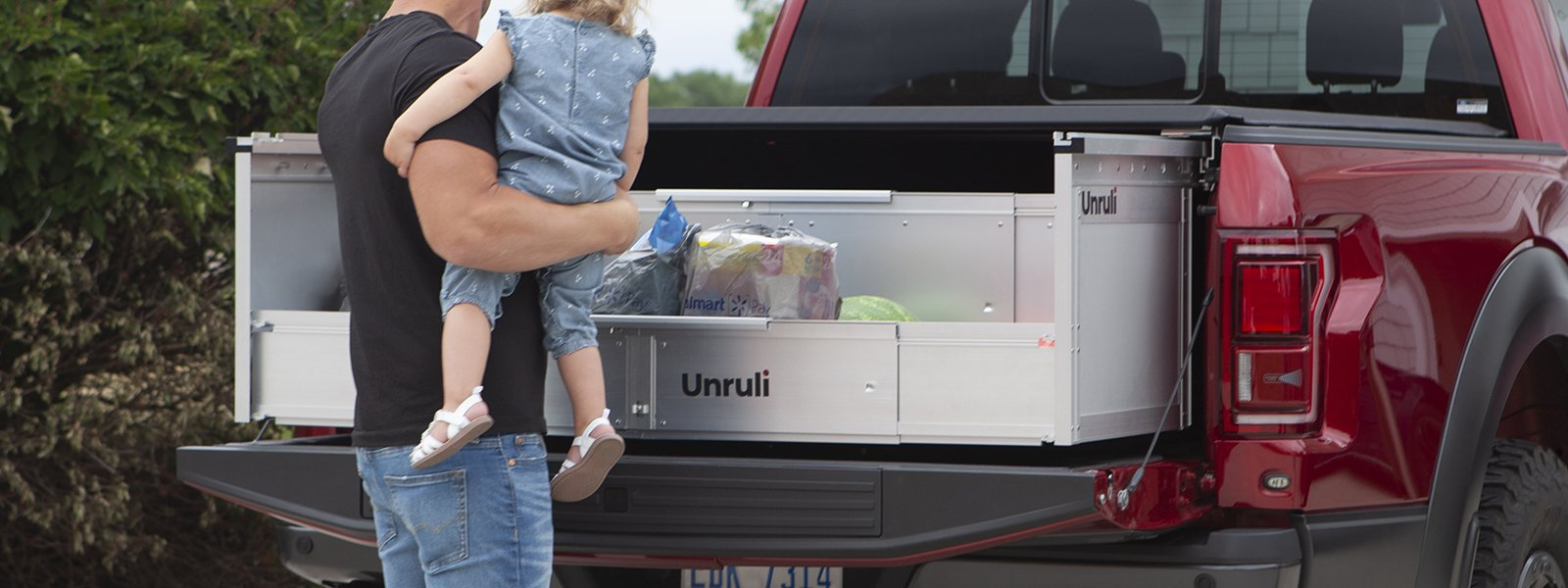 father and daughter pickup truck unloading groceries