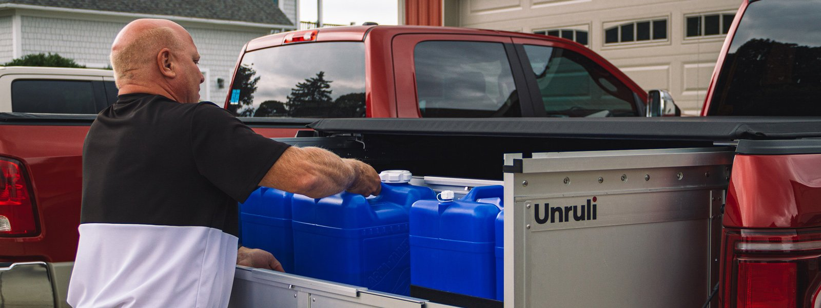 pickup truck cargo box with water jugs and straps