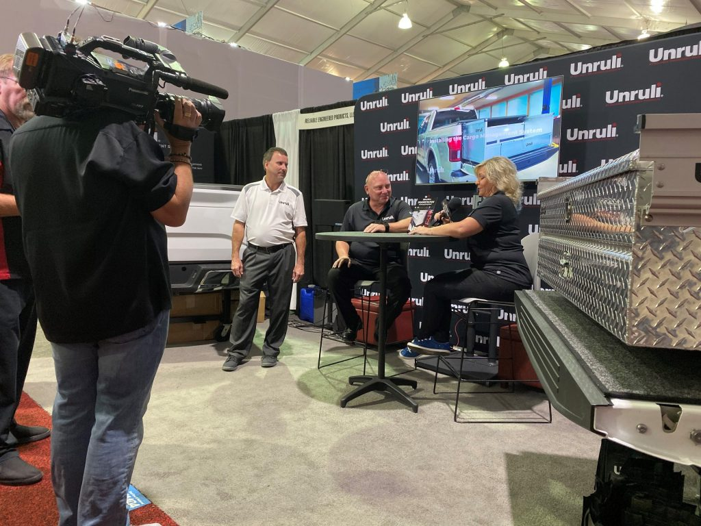Unruli booth at SEMA 2019