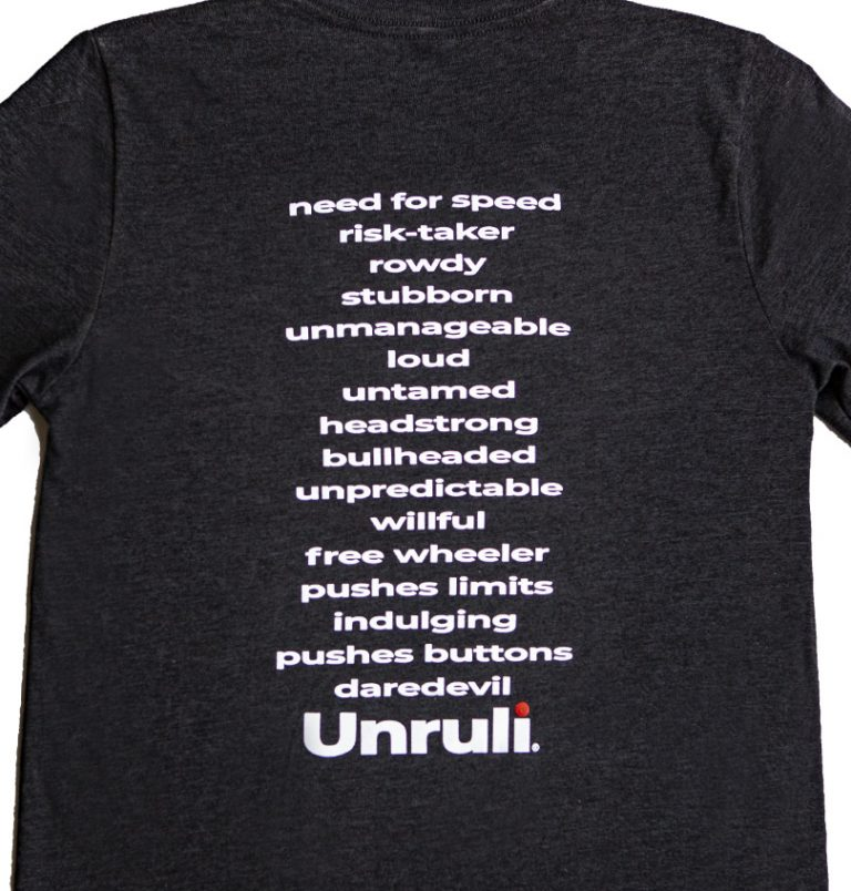 unruly traits on back of t-shirt